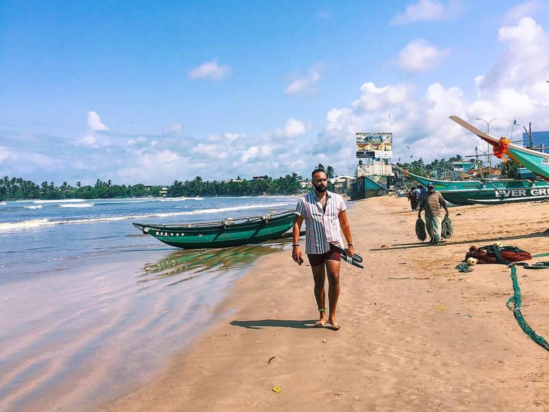 Caleb Joseph walking on a beach in Sri Lanka during a family holiday.